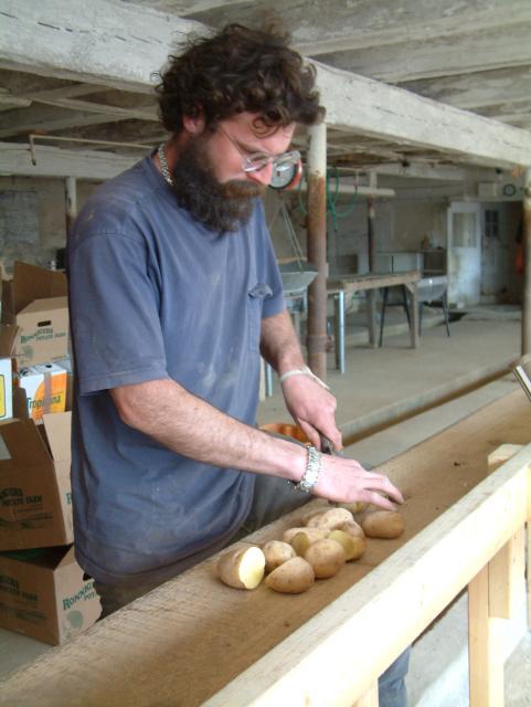 Johnny cutting seed potatoes